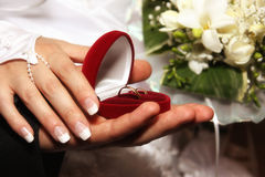 Hand of the groom and the bride. With wedding bouquet Royalty Free Stock Image