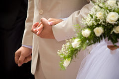 Wedding. Hand of the groom and the bride Royalty Free Stock Image