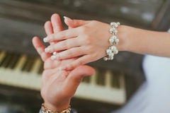 Hand of the groom and the bride Royalty Free Stock Images