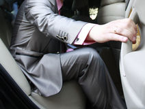 Hand of the groom closing car door Stock Photos