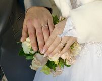 Hand of groom and fiancee Stock Images