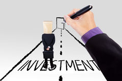 Hand guiding person to investment door. Businessman hand drawing a road with an investment text and guiding a person to a door Stock Images