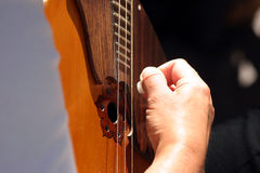 Hand on guitar stock images