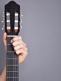 Hand on guitar Stock Photography