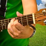 Hand and guitar Royalty Free Stock Photos
