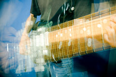 Hand on guitar. Hand in motion on electric guitar, strobe lighting Stock Image