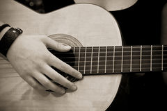 Hand on guitar. Royalty Free Stock Photos