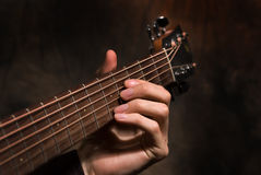 Hand with a guitar Royalty Free Stock Photos
