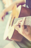 Hand on guitar Royalty Free Stock Photo