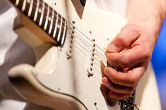 Hand of guitar player stock image