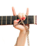 Hand and guitar Stock Photos