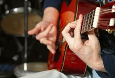 Hand of guitarist Royalty Free Stock Photos