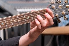 The hand of the guitarist on fingerboard. The hand of the guitarist on the fingerboard royalty free stock photos
