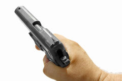 Hand and gun Stock Images