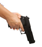 Hand and gun. Hand holding a black pistol on white background Stock Images