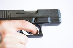 Hand with a gun. Closeup of a hand gun with a white background Royalty Free Stock Photography