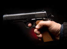 Hand with gun Stock Photo