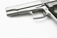 Hand gun. A Hand gun isolated on a white background Stock Photo
