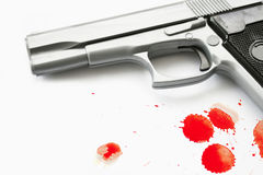Hand gun. A Hand gun isolated on a white background with blood splatters Royalty Free Stock Photo