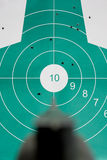 Hand gun aim straight at target Stock Photo