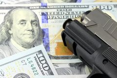 Hand Gun with American Currency Stock Image