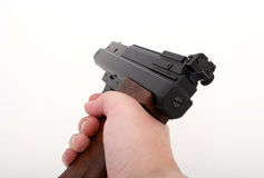 Hand gun being aimed. Isolated on over white Stock Photography