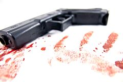 Hand gun with blood Royalty Free Stock Image