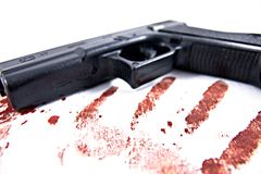 Hand gun with blood Royalty Free Stock Photography