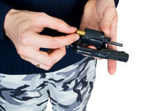 Hand gun charge on a white Stock Image