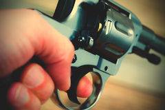 Hand with gun. Close-up. instagram image filter retro style Stock Photos