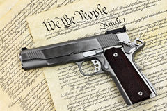 Hand Gun and Constitution royalty free stock photo