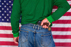Hand on gun with flag Royalty Free Stock Image