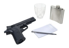 Hand Gun, Flask and Notepad Royalty Free Stock Images