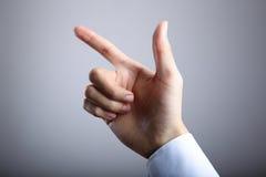 Hand of gun gesture Stock Images