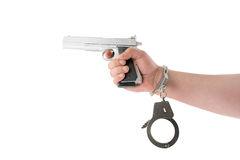 Hand with gun and handcuffs isolated Royalty Free Stock Image