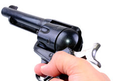 Hand Gun. Hand holding a six shooter revolver isolated on white Stock Photography