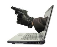 Hand with gun in laptop monitor. Hand with gun stick out from laptop monitor isolated on white. Internet piracy concept stock photos