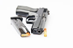 Hand gun and magazine. Automatic 9 mm.hand gun and magazine Stock Photos