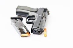 Hand gun and magazine Stock Photos