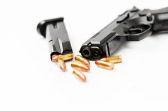 Hand gun and magazine Stock Images
