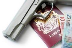Hand Gun & Passport. A hand Gun, Passport and Money set on a white background base Stock Photo