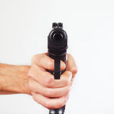 Hand with gun pointing forward close up Royalty Free Stock Image
