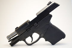 Hand gun with slide locked. Image of a handgun with the slide locked into place Stock Photography