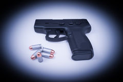 Hand Gun - Spotlighted 45 Auto and Bullets Stock Images