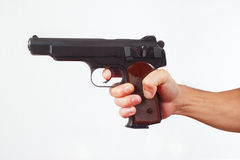 Hand with gun on white background Royalty Free Stock Image