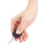 Hand hält Autoschlüssel Stockbild