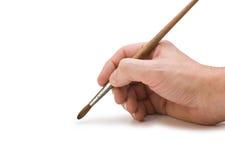 Hand hält den Pinsel an, um zu zeichnen lizenzfreie stockbilder