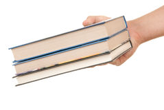 Hand hält drei Bücher an Stockbilder