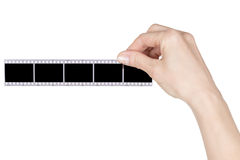 Hand hält ein Negativ lizenzfreie stockbilder