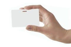 Hand hält ein weißes Abzeichen an Stockbilder